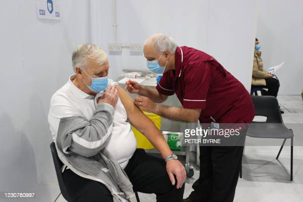 Robert Ward a retired nurse from Blackpool Victoria Hospital, injects a patient with a dose of the Oxford/AstraZeneca Covid-19 vaccine during a...