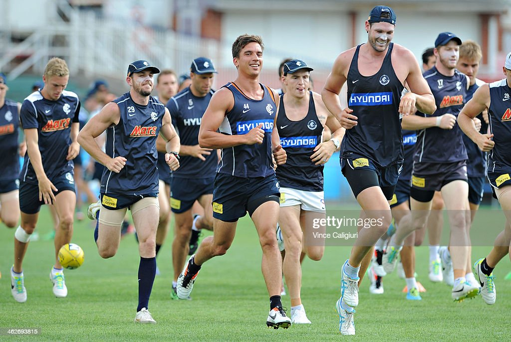 Robert Warnock and Andrew Carrazzo (ctr) of the blues during a Carlton Blues AFL pre-season training session at Visy Park on January 15, 2014 in Melbourne, Australia.