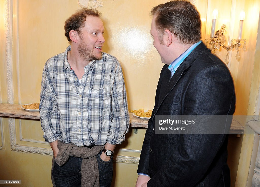 Robert Webb (L) and Rufus Hound attend an after party celebrating the new cast of 'One Man, Two Guvnors' at the Theatre Royal Haymarket on February 12, 2013 in London, England.