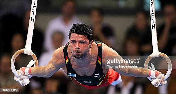 Robert Weber of Germany performs at the rings during the EnBW Gymnastics Worldcup 2010 at the Porsche Arena on November 13 2010 in Stuttgart Germany