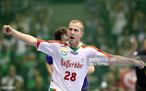Robert Weber of Magdeburg celebrates during the Toyota Handball Bundesliga match between SC Magdeburg and Rhein Neckar Loewen at the Boerdeland Hall...