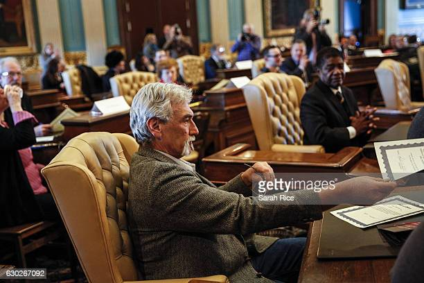 Robert Weitt a Michigan representative to the electoral college hands in his signed vote for Presidentelect Donald Trump at the Michigan State...