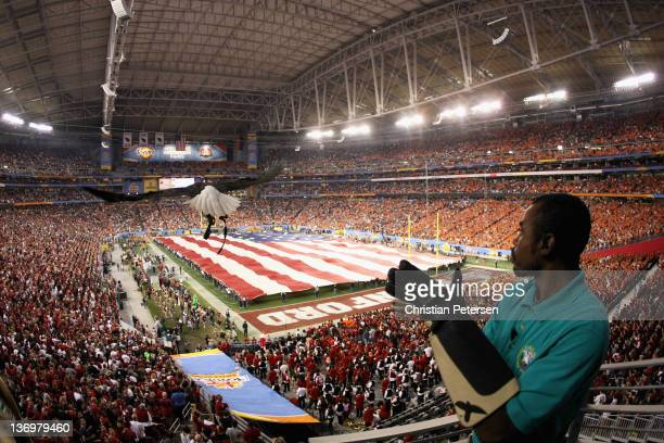 Robert West of the American Eagle Association releases Challenger during National Anthem before the Tostitos Fiesta Bowl between Oklahoma State...