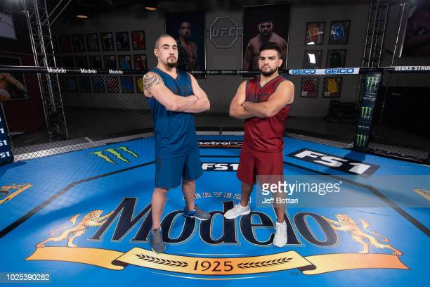 Robert Whittaker and Kelvin Gastelum pose for a portrait during the filming of The Ultimate Fighter Heavy Hitters on July 13 2018 in Las Vegas Nevada