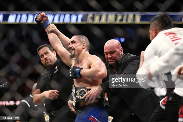 Robert Whittaker celebrates after his victory over Yoel Romero in their interim UFC middleweight championship bout during the UFC 213 event at...