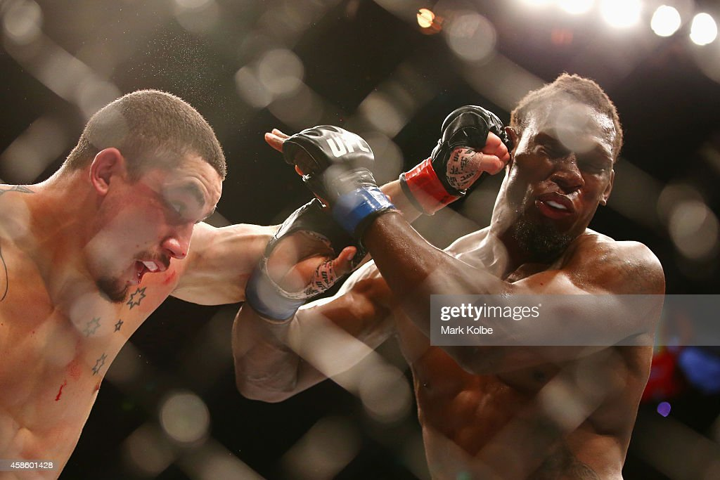 Robert Whittaker connects with a left to the face of Clint Hester in their middleweight fight during the UFC Fight Night 55 event at Allphones Arena on November 8, 2014 in Sydney, Australia.