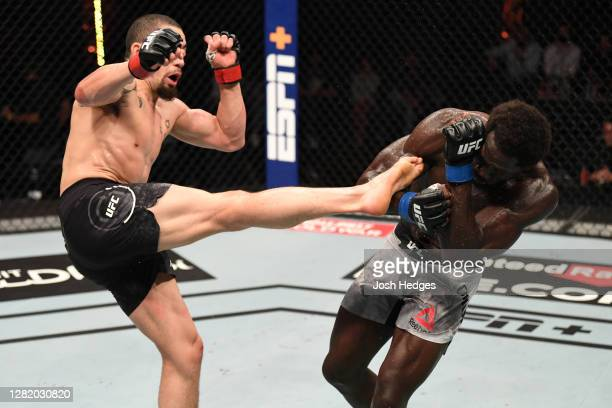 Robert Whittaker of Australia kicks Jared Cannonier in their middleweight bout during the UFC 254 event on October 25, 2020 on UFC Fight Island, Abu...
