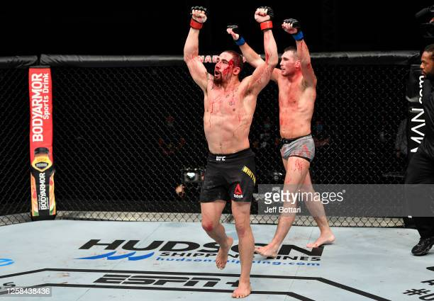 Robert Whittaker of New Zealand and Darren Till of England react after the conclusion of their middleweight fight during the UFC Fight Night event...