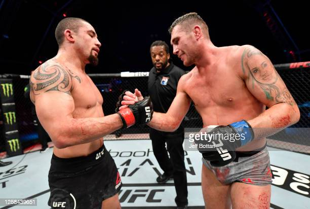 Robert Whittaker of New Zealand and Darren Till of England talk after their middleweight fight during the UFC Fight Night event inside Flash Forum on...