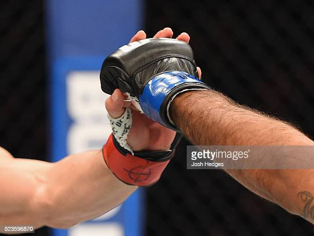 Robert Whittaker of New Zealand and Rafael Natal touch gloves before their middleweight bout during the UFC 197 event inside MGM Grand Garden Arena...