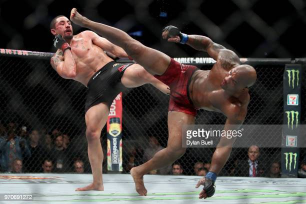 Robert Whittaker of New Zealand and Yoel Romero of Cuba each attempt a kick in the fifth round in their middleweight title fight during the UFC 225...