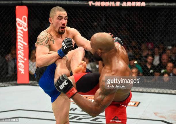Robert Whittaker of New Zealand and Yoel Romero of Cuba exchange kicks in their interim UFC middleweight championship bout during the UFC 213 event...