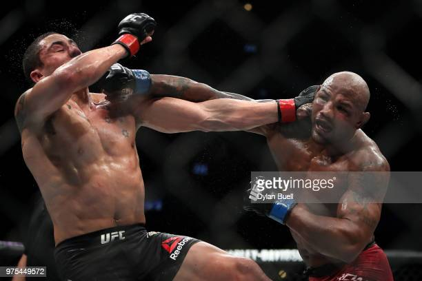 Robert Whittaker of New Zealand and Yoel Romero of Cuba exchange punches in the fifth round in their middleweight title fight during the UFC 225...