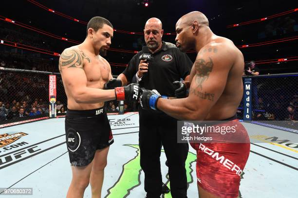 Robert Whittaker of New Zealand and Yoel Romero of Cuba touch gloves prior to their middleweight fight during the UFC 225 event at the United Center...