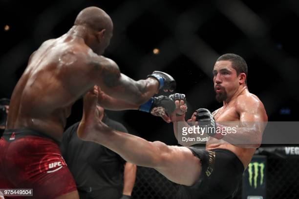 Robert Whittaker of New Zealand attempts a kick against Yoel Romero of Cuba in the fourth round in their middleweight title fight during the UFC 225...