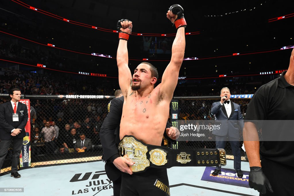 Robert Whittaker of New Zealand celebrates after defeating Yoel Romero of Cuba by split decision in their middleweight fight during the UFC 225 event at the United Center on June 9, 2018 in Chicago, Illinois.
