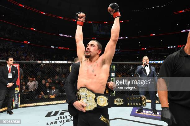 Robert Whittaker of New Zealand celebrates after defeating Yoel Romero of Cuba by split decision in their middleweight fight during the UFC 225 event...