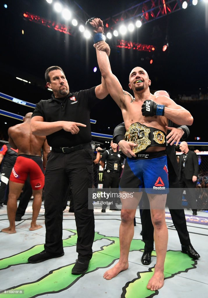 Robert Whittaker of New Zealand celebrates after his unanimous-decision victory over Yoel Romero of Cuba in their interim UFC middleweight championship bout during the UFC 213 event at T-Mobile Arena on July 8, 2017 in Las Vegas, Nevada.