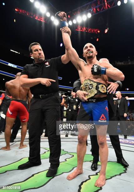 Robert Whittaker of New Zealand celebrates after his unanimousdecision victory over Yoel Romero of Cuba in their interim UFC middleweight...