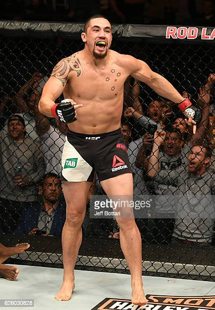 Robert Whittaker of New Zealand celebrates his TKO victory over Derek Brunson in their middleweight bout during the UFC Fight Night event at Rod...