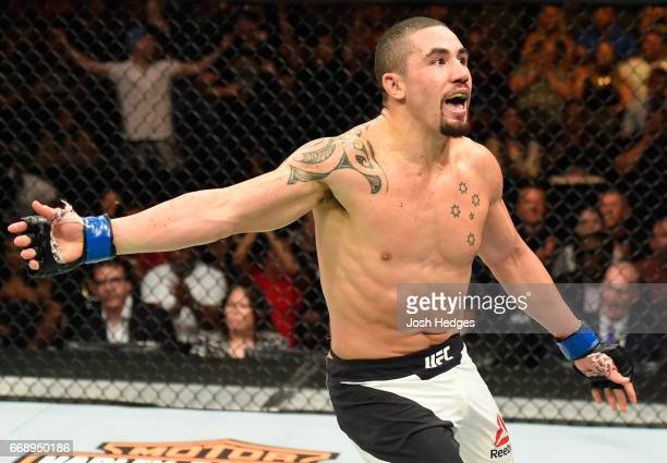 Robert Whittaker of New Zealand celebrates his TKO victory over Jacare Souza of Brazil in their middleweight fight during the UFC Fight Night event...