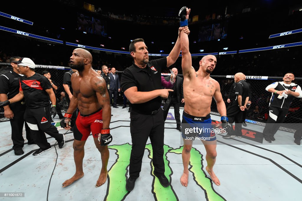 Robert Whittaker of New Zealand celebrates his victory over Yoel Romero of Cuba in their interim UFC middleweight championship bout during the UFC 213 event at T-Mobile Arena on July 8, 2017 in Las Vegas, Nevada.