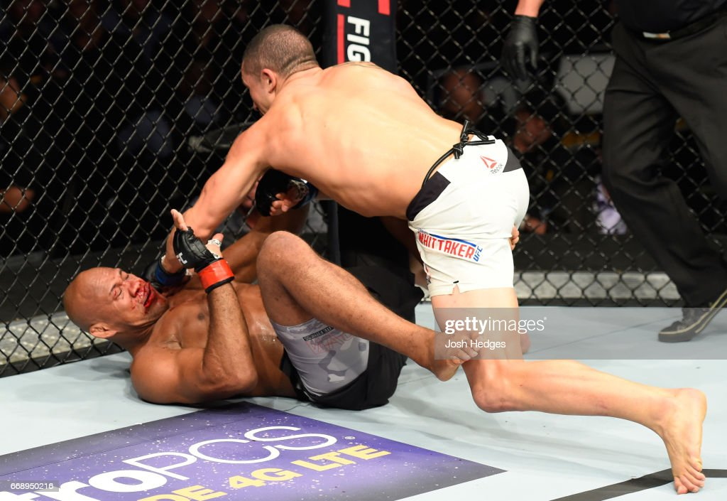 Robert Whittaker of New Zealand elbows Jacare Souza of Brazil in their middleweight fight during the UFC Fight Night event at Sprint Center on April 15, 2017 in Kansas City, Missouri.