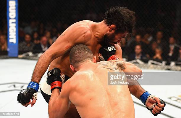 Robert Whittaker of New Zealand exchange strikes with Rafael Natal in their middleweight bout during the UFC 197 event inside MGM Grand Garden Arena...