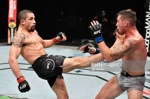 Robert Whittaker of New Zealand kicks Darren Till of England in their middleweight fight during the UFC Fight Night event inside Flash Forum on UFC...
