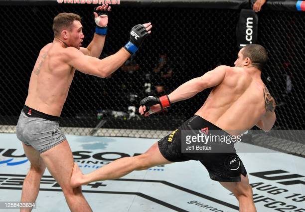 Robert Whittaker of New Zealand kicks the leg of Darren Till of England in their middleweight fight during the UFC Fight Night event inside Flash...