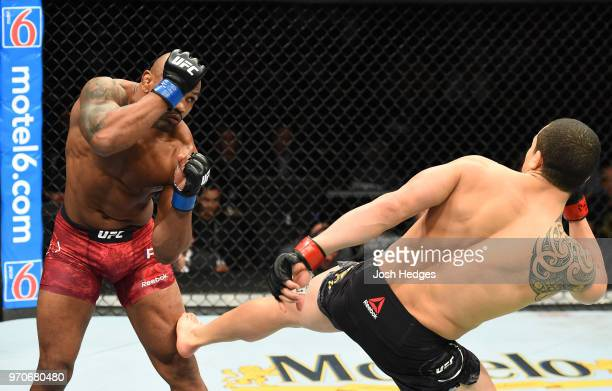 Robert Whittaker of New Zealand kicks Yoel Romero of Cuba in their middleweight fight during the UFC 225 event at the United Center on June 9 2018 in...