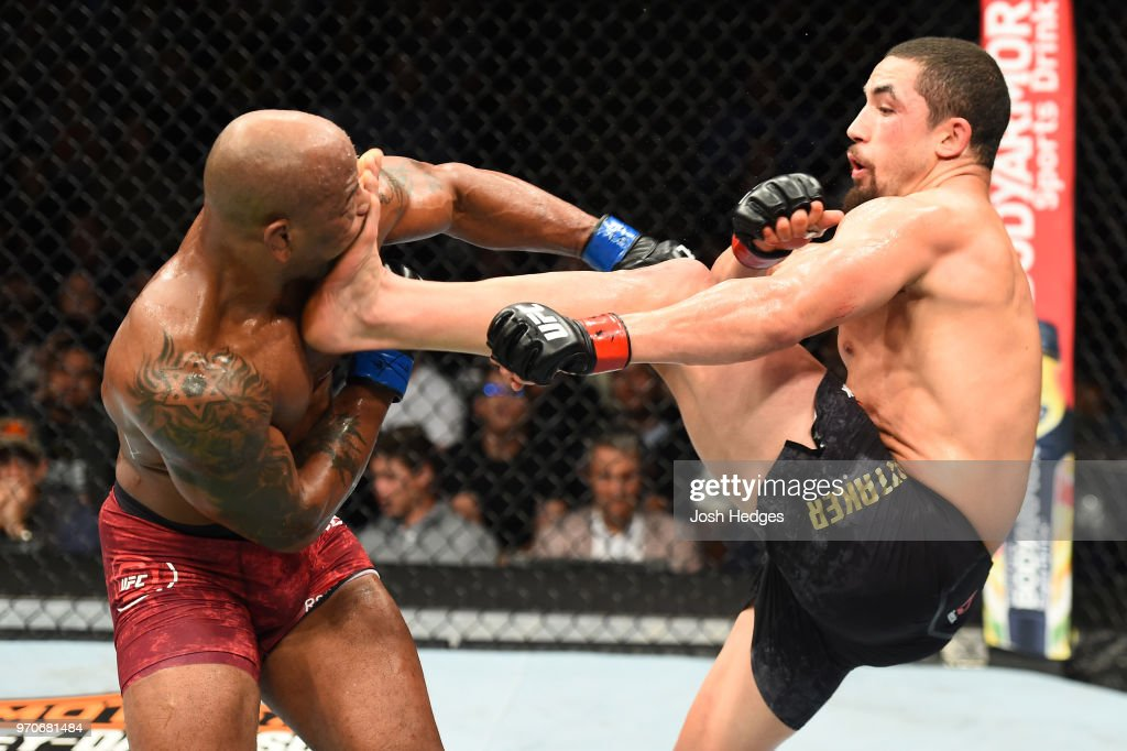 Robert Whittaker of New Zealand lands a front kick to the face of Yoel Romero of Cuba in their middleweight fight during the UFC 225 event at the United Center on June 9, 2018 in Chicago, Illinois.