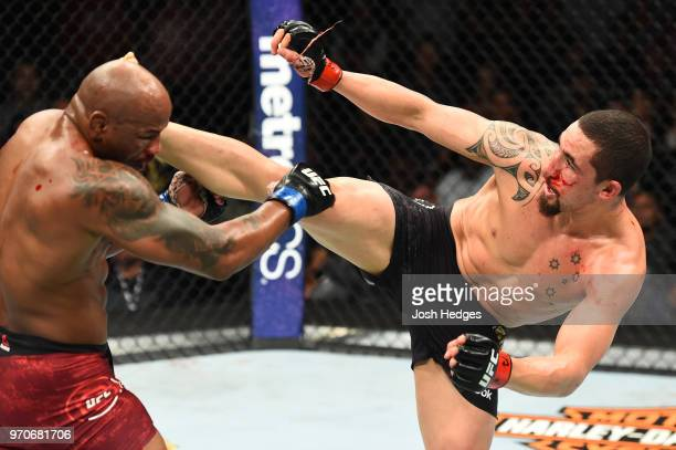Robert Whittaker of New Zealand lands a kick to the head of Yoel Romero of Cuba in their middleweight fight during the UFC 225 event at the United...