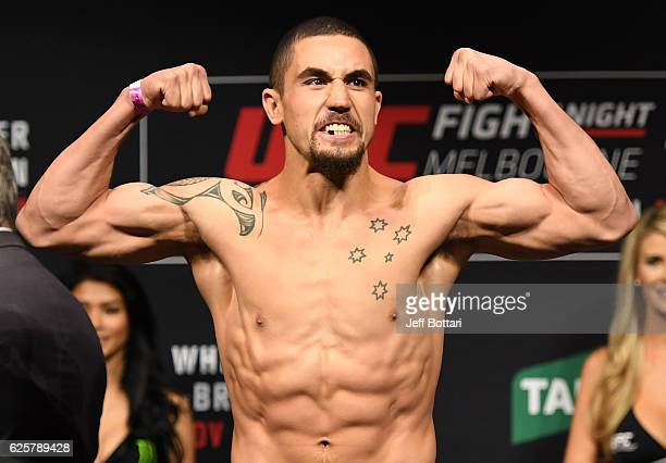 Robert Whittaker of New Zealand poses on the scale during the UFC weighin at Rod Laver Arena on November 26 2016 in Melbourne Australia