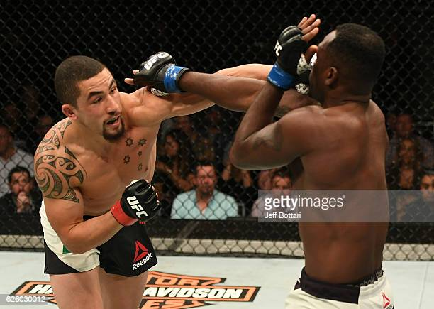 Robert Whittaker of New Zealand punches Derek Brunson in their middleweight bout during the UFC Fight Night event at Rod Laver Arena on November 27...