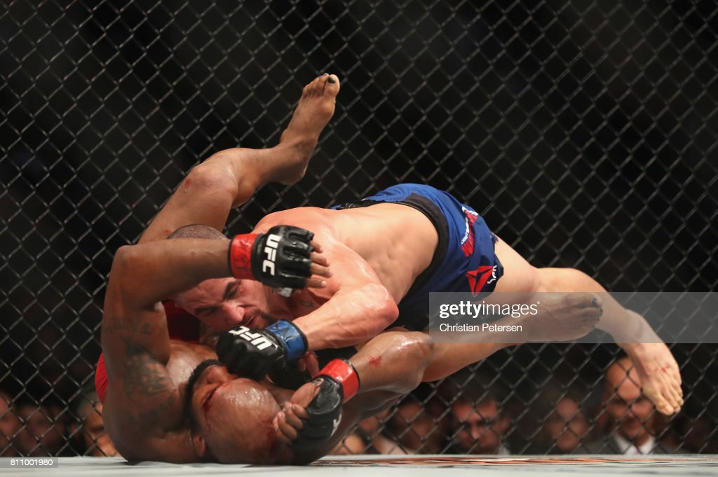 Robert Whittaker of New Zealand punches Yoel Romero of Cuba in their interim UFC middleweight championship bout during the UFC 213 event at T-Mobile Arena on July 8, 2017 in Las Vegas, Nevada.