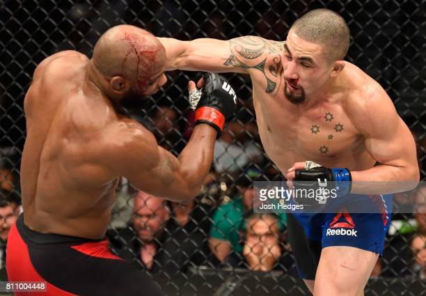 Robert Whittaker of New Zealand punches Yoel Romero of Cuba in their interim UFC middleweight championship bout during the UFC 213 event at TMobile...