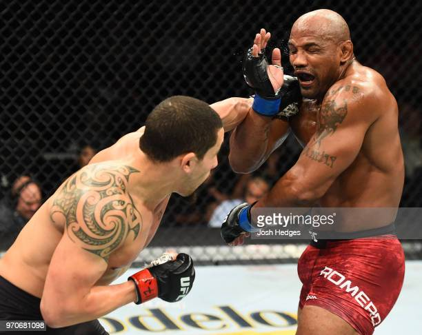 Robert Whittaker of New Zealand punches Yoel Romero of Cuba in their middleweight fight during the UFC 225 event at the United Center on June 9 2018...