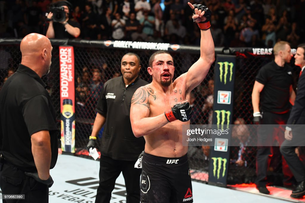 Robert Whittaker of New Zealand reacts after finishing five rounds against Yoel Romero of Cuba in their middleweight fight during the UFC 225 event at the United Center on June 9, 2018 in Chicago, Illinois.