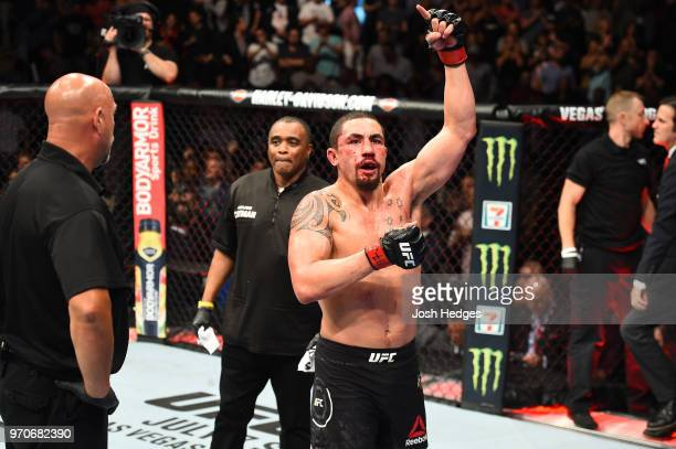 Robert Whittaker of New Zealand reacts after finishing five rounds against Yoel Romero of Cuba in their middleweight fight during the UFC 225 event...