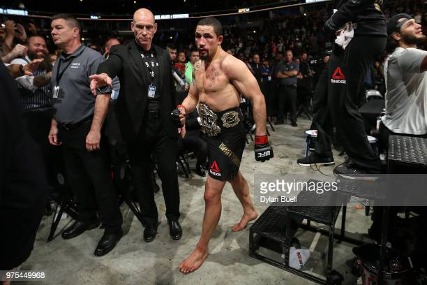 Robert Whittaker of New Zealand walks off after defeating Yoel Romero of Cuba in their middleweight title fight during the UFC 225 Whittaker v Romero...
