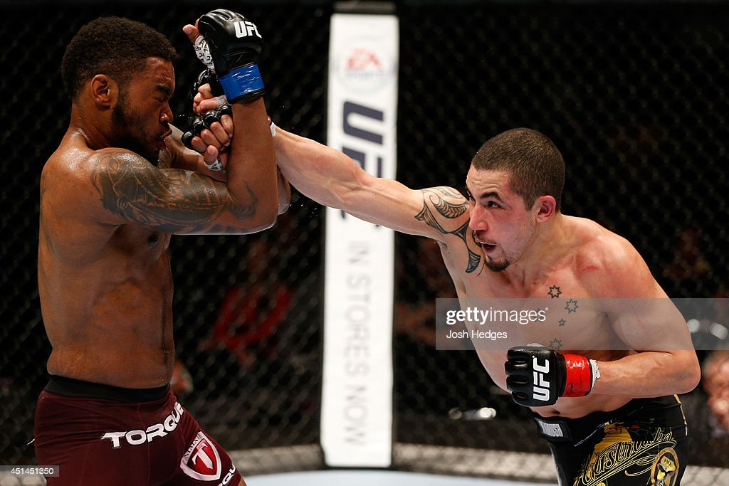 Robert Whittaker punches Mike Rhodes in their welterweight fight during the UFC Fight Night event at Vector Arena on June 28, 2014 in Auckland, New Zealand.