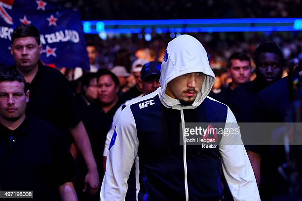 Robert Whittaker walks to the Octagon before fighting against Uriah Hall in their middleweight bout during the UFC 193 event at Etihad Stadium on...