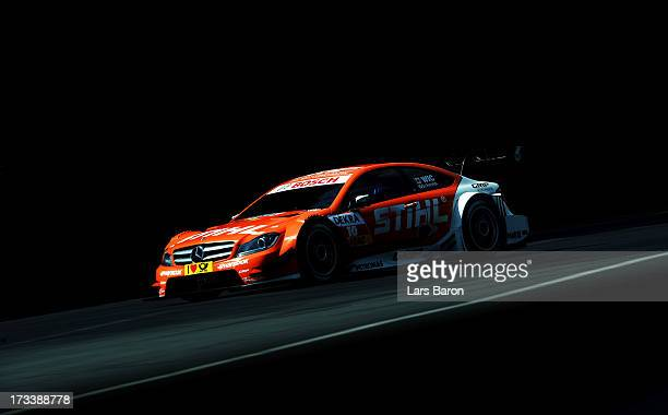 Robert Wickens of Canada and STIHL Mercedes AMG drives during the qualifying for the fifth round of the DTM 2013 German Touring Car Championship at...