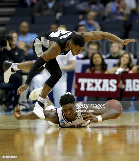 Robert Williams of the Texas AM Aggies dives for ball possession againt Kyron Cartwright of the Providence Friars during the first round of the 2018...