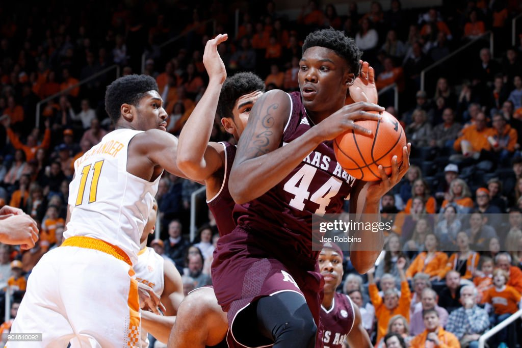 Robert Williams #44 of the Texas A&M Aggies rebounds against Kyle Alexander #11 of the Tennessee Volunteers in the first half of a game at Thompson-Boling Arena on January 13, 2018 in Knoxville, Tennessee. Tennessee won 75-62.