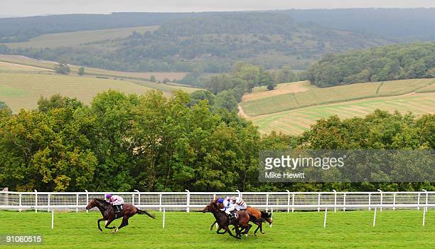 Robert Winston on Agent Archie storm to victory in the EBF Goodwood Food Maiden Stakes at Goodwood racecourse on September 23 2009 in Chichester...