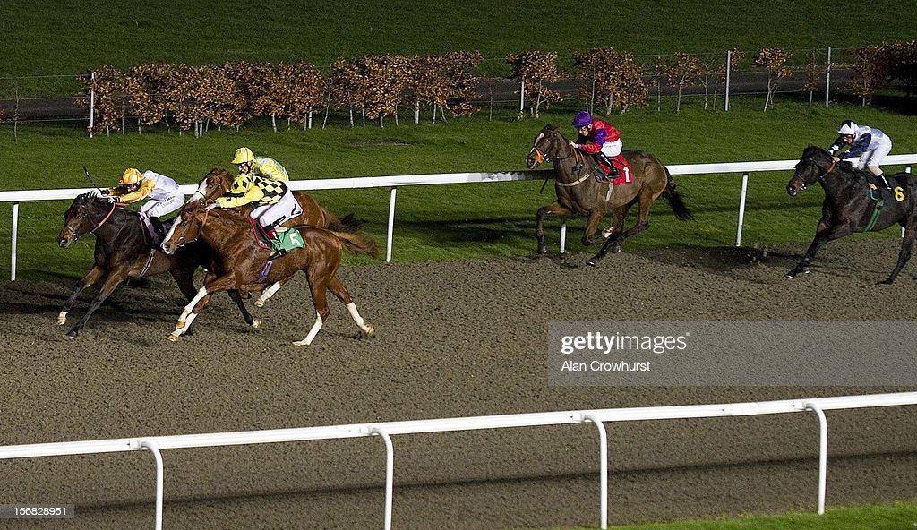Robert Winston riding Jack Of Diamonds (L) win The 32Red Casino Handicap Stakes at Kempton racecourse on November 22, 2012 in Sunbury, England.