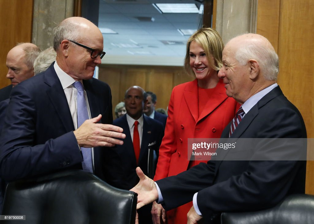 Robert Wood Johnson IV (L) and Kelly Knight Craft talk with Sen. Ben Cardin (D-MD) (R) before their Senate Foreign Relations Committee confirmation hearing on Capitol Hill, June 20, 2017 in Washington, DC. Johnson was nominated to be ambassador to the United Kingdom and Kraft to ambassador to Canada.