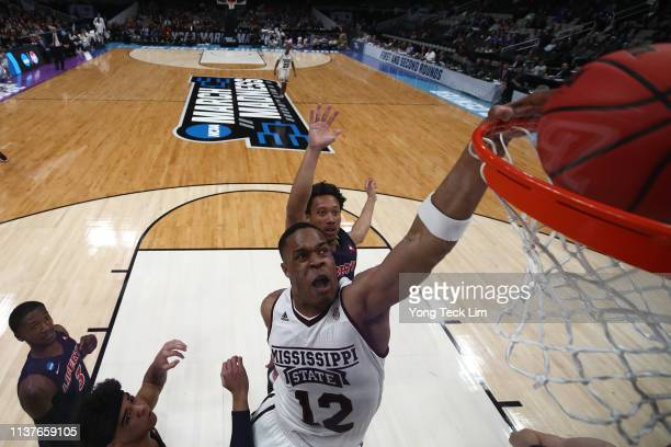 Robert Woodard of the Mississippi State Bulldogs dunks the ball against the Liberty Flames during their game in the First Round of the NCAA...